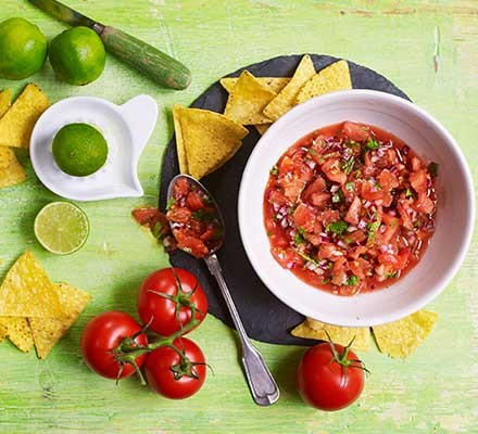 Tomato salsa with the ingredients alongside