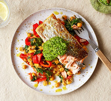 Salsa verde salmon with smashed chickpea salad served on a plate