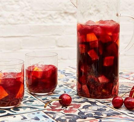 Sangria in a jug and two glasses