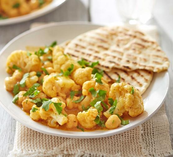 Satay cauliflower & chickpea curry with storecupboard flatbreads