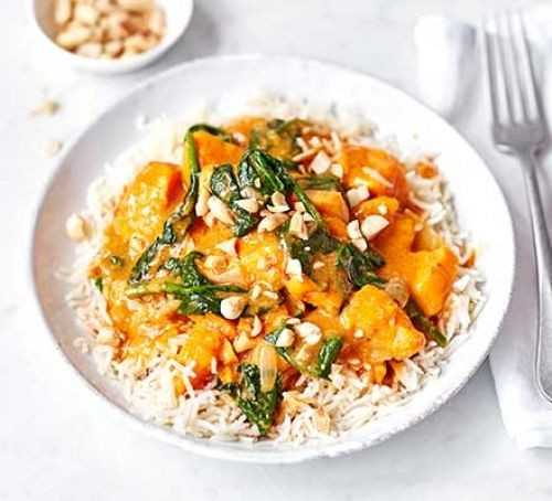 Satay sweet potato curry with spinach on a bed of rice