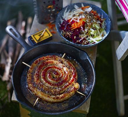 Sticky cider & mustard sausage wheel with box grater salad