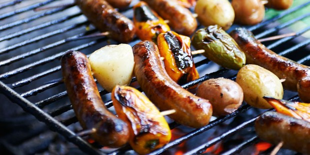 Sausages and vegetables on barbecue grill