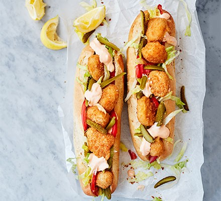Scampi served in baguettes with salad