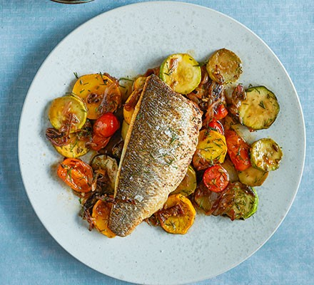 Sea bass with braised courgettes & harissa mayo served on a plate