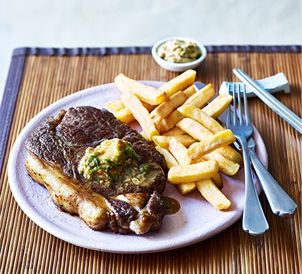 Steak with soy-ginger butter served on a plate with chips