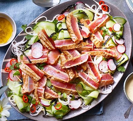 Seared tuna & cucumber salad served on a plate