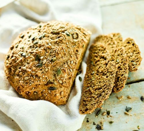 Seeded soda bread loaf with slices