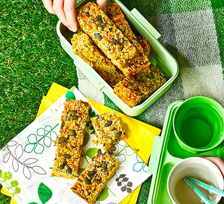 Seeded cheese & chive flapjacks in tupperware at a picnic