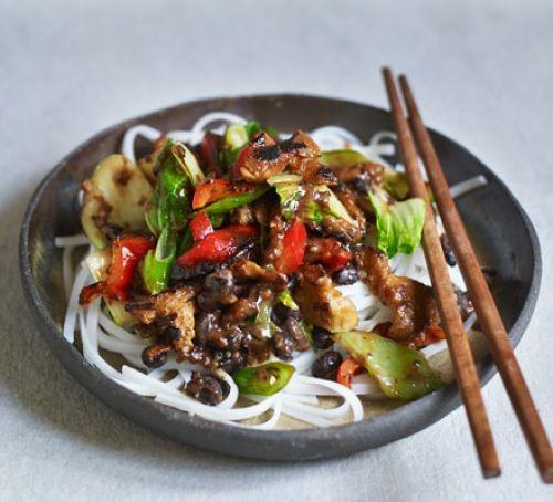 Seitan stir fry in a bowl with chopsticks