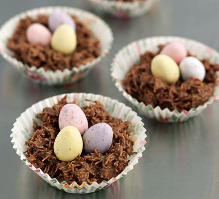 Chocolate Easter nests with chocolate eggs in cases