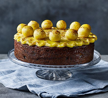 Easter simnel cake served on a cake stand