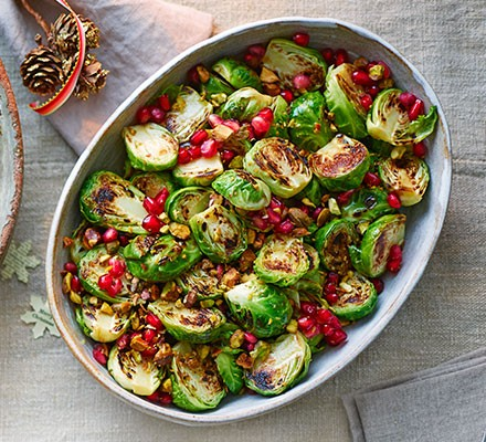 Sizzled sprouts with pistachios & pomegranate served in a dish