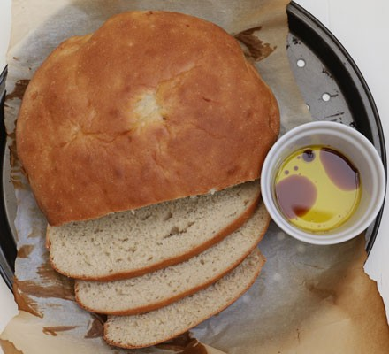 Bread sliced with oil and balsamic in bowl
