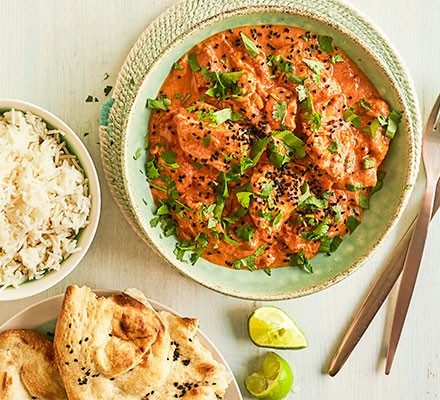 Slow cooker chicken tikka masala served with rice and naan bread