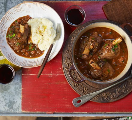 Lamb stew with mashed potatoes on plate and stew in dish