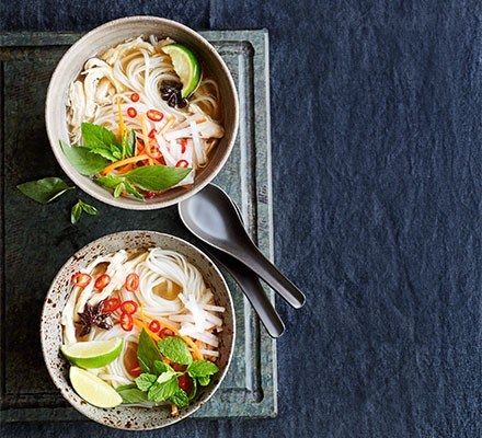 Slow cooker turkey pho served in two bowls