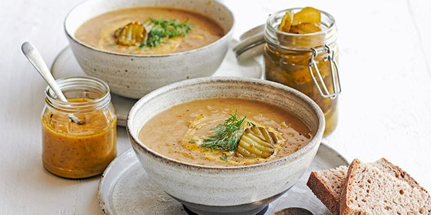 Danish split pea slow cooker soup served in bowls with mustard
