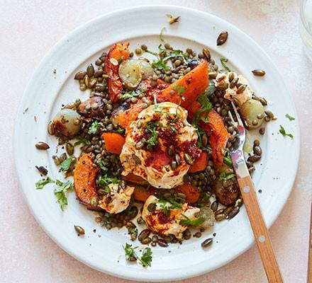 Slow-roast squash & garlic lentils with harissa yogurt served on a plate