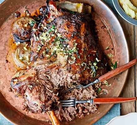 Slow-roasted shoulder of lamb on a large metal platter