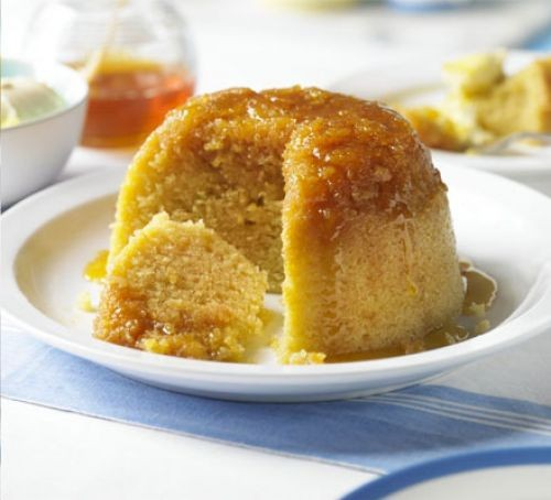 Treacle sponge with slice taken out, on a plate