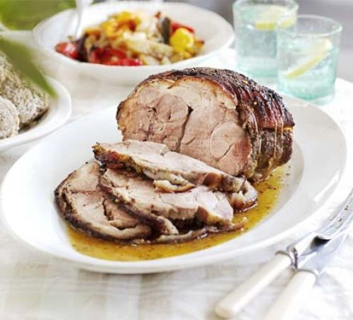 Sliced roast pork shoulder with sauce