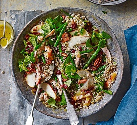 Smoked chicken, pot barley & cranberry salad served in a bowl