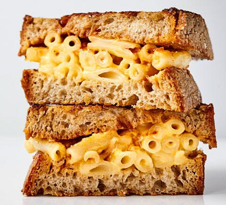 A smoked mac 'n' cheese sandwich cut into two
