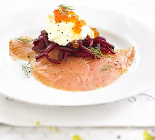 Smoked salmon topped with beetroot and cream