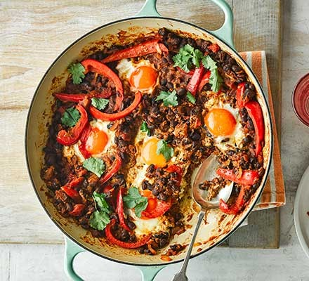 Smoky beans & baked eggs in a casserole dish