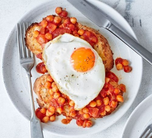 Chickpeas on toast with fried egg on plate