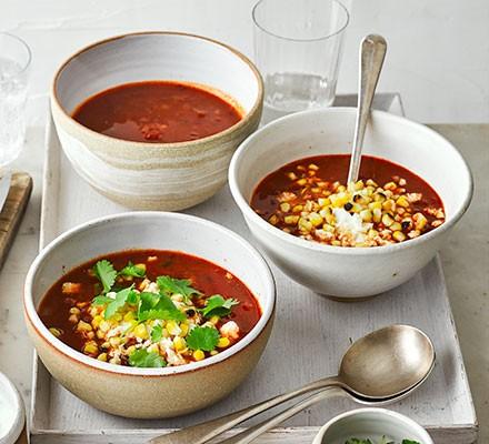 Smoky tomato, chipotle & charred corn soup in three bowls