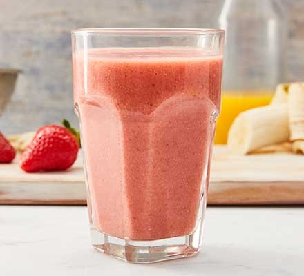 Strawberry smoothie served in a tall glass