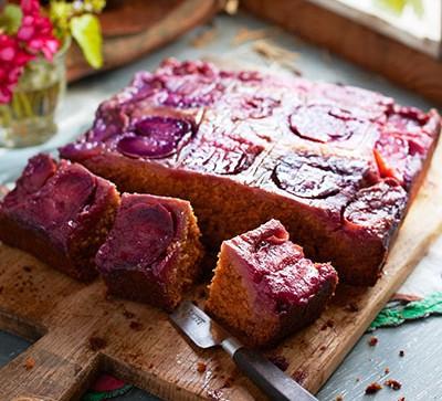 Plum cake on wooden board
