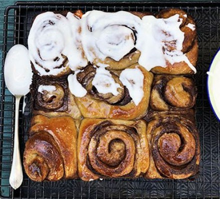 Sourdough cinnamon buns, half of the tray iced, the other half un-iced