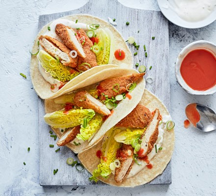 Chicken and salad in tortillas with sauces