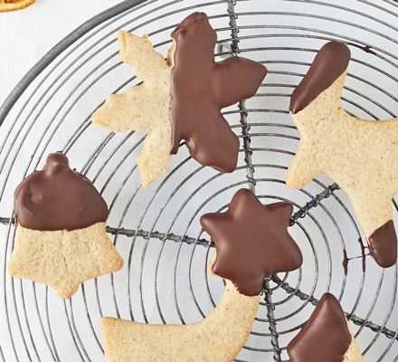 Chocolate dipped cookies on wire cooling rack