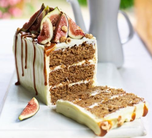 Iced coffee loaf cake with three layers, topped with figs and glaze