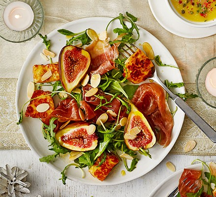 Spiced honey-glazed halloumi & fig salad served on a plate