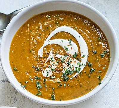 Spiced lentil & butternut squash soup in white bowl