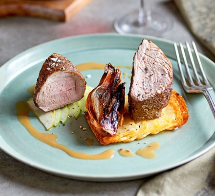 Spiced pork fillet with shallots & apple