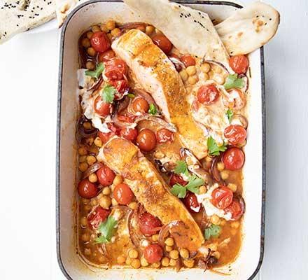 Spiced salmon & tomato traybake served in a roasting tin