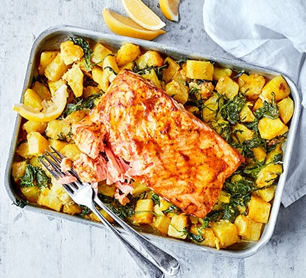 Spiced salmon with traybaked sag aloo in a serving dish