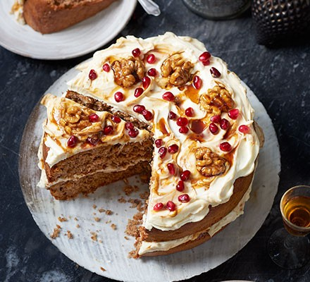 Spiced walnut cake with a slice cut out
