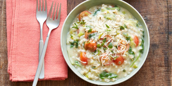 A bowl of spinach and barley risotto