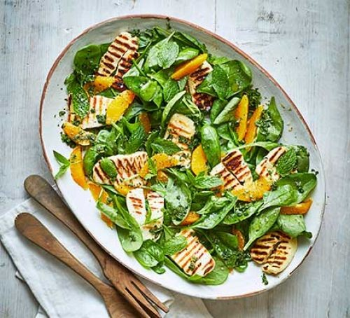 Spinach and halloumi salad in a plate