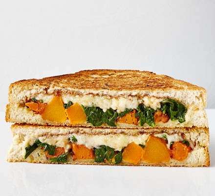 Squash and spinach toastie cut in half