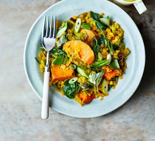 Sweet potato curry on plate with fork