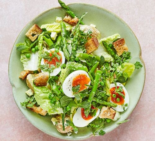Plate of egg, asparagus and lettuce salad with croutons