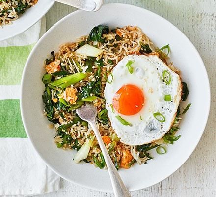 Spring green fried rice & eggs served on a plate